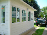 The sunroom with siding and windows installed