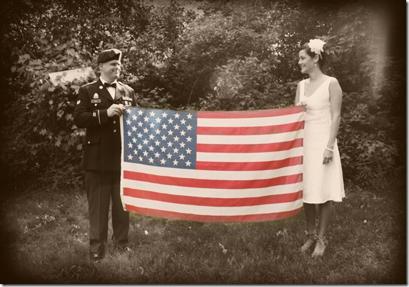 looking at each othe holding flag sepia and color