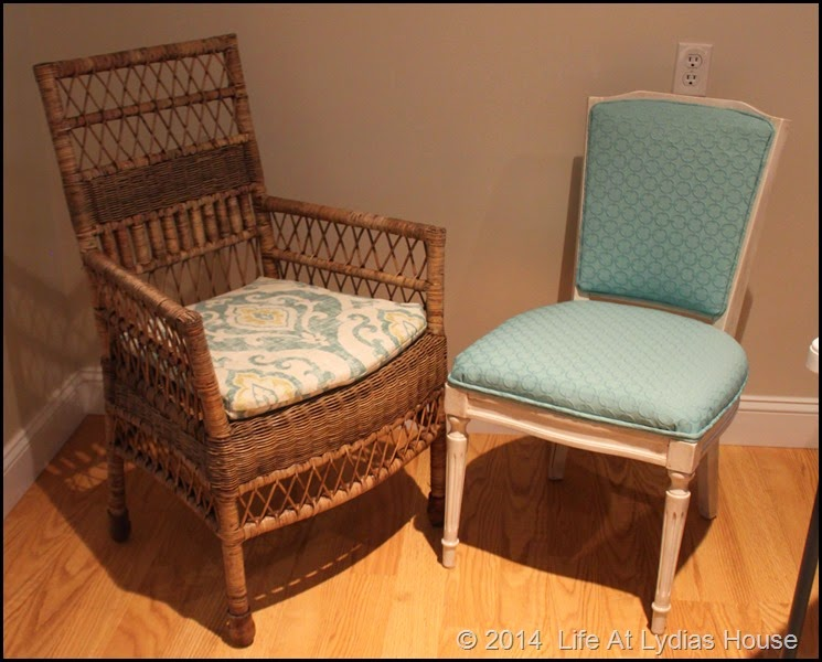 wicker chair w upholstered chair