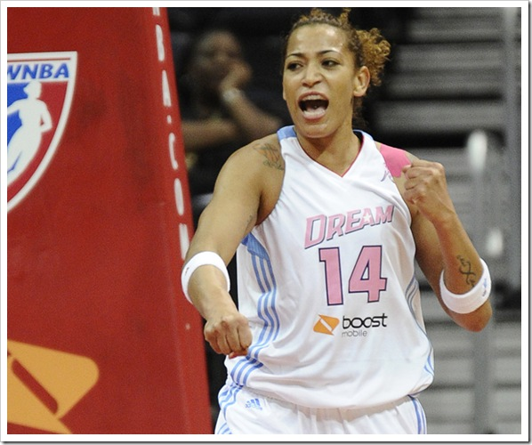 Staff Photo: John Bohn Erika de Souza celebrates her scoring of two points during a WNBA game against the Atlanta Dream.