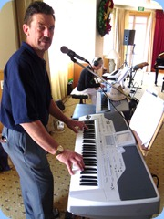 Acting Secretary of the Club, Peter Littlejohn, played and sang along with his Korg Pa1X.