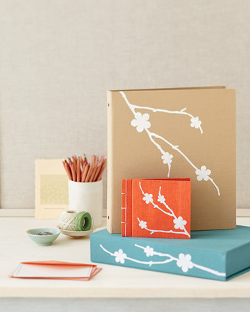 Apply delicate silhouettes such as the cherry branches to colored photo books and albums for a stunning memory keeper. (marthastewart.com)