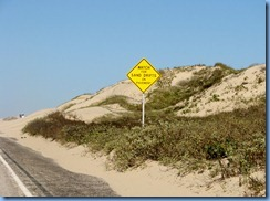 6665 Texas, South Padre Island - Watch For Sand Drifts On Pavement sign