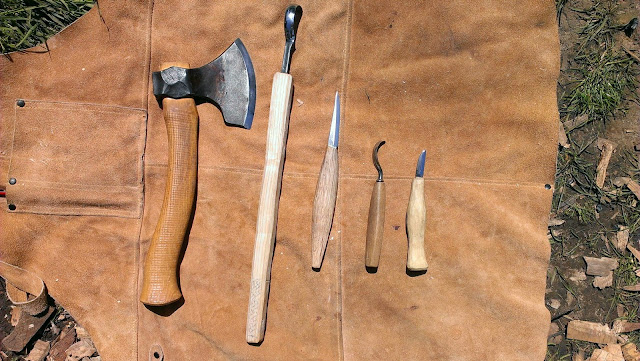Carved spoons sharpening in the sunshine