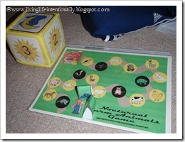 Nocturnal Farm Animals game: 2 gameboards, 4 primary color tractor game pieces, 6 photo cube die inserts