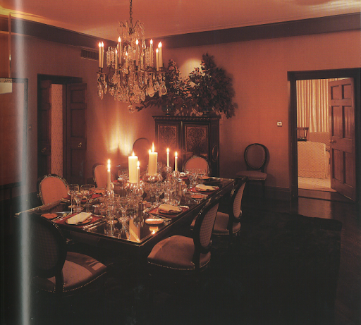 Isn't this dining table stunning? I love how the glass top reflects flickering candlelight.