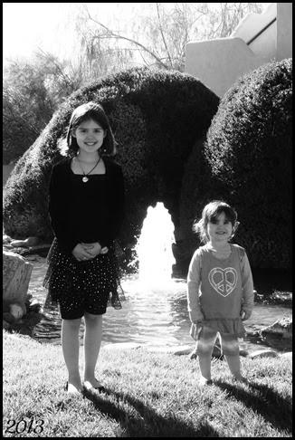 b&w girls with fountain