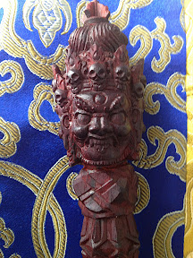 Detail of one of three faces: Dharmakaya, Sambhogakaya and Nirmanakaya. This is the wrathful Nirmankaya, with 5 skull crown, varja topknot, etc.