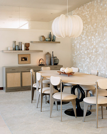 A capiz-shell curtain creates a shimmering backdrop in the dining area, which is mostly soft whites and cool grays.