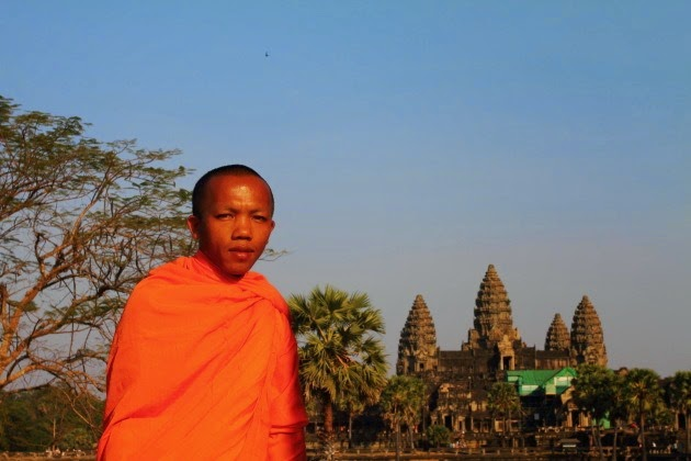 Buddhist Monk poses in front of Angkor Wat