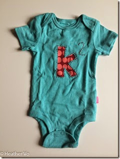 Reverse Applique Onesie by Heather Vo