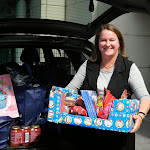 Mary delivering Christmas gifts donated to Doncare by Doncaster residents