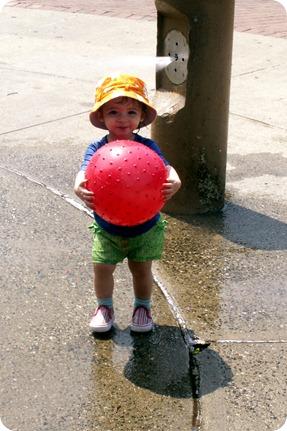 Elaine in the water sprinkler at McKinley Park