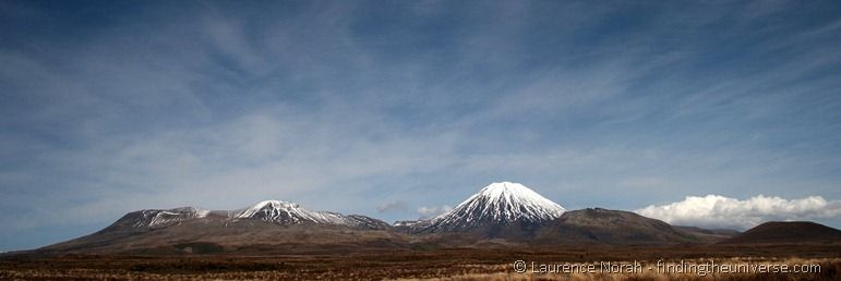 Mount Ngauruhoe (right) and Mt Tongariro (left). Ngaurahoe also known as Mt. Doom :). We live about a five minute drive from this view. Expect to see more pictures like this!