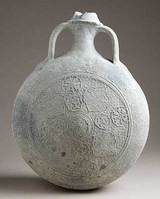Canteen Iran Canteen, 14th century Ceramic; Vessel, Fritware, unglazed, 12 x 9 1/4 x 4 1/4 in. (30.48 x 23.50 x 10.80 cm) Gift of Andrew Hale and Kate Fitz Gibbon (AC1998.223.1) Art of the Middle East: Islamic Department.