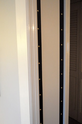 grosgrain ribbon and upholstery tacks around doorways