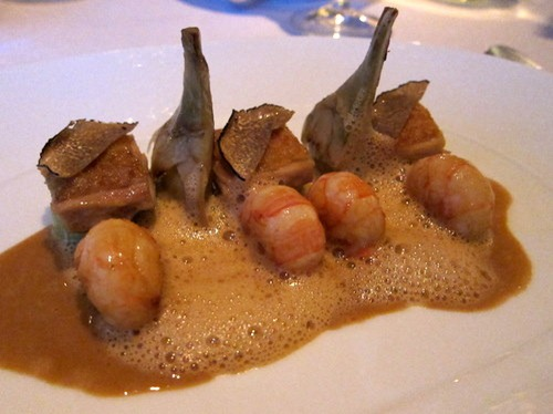 Roasted langoustine tails with confit chicken leg, baby artichokes and buttered leeks