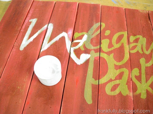 painting in the letters of the sign