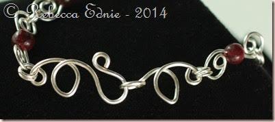 garnet swirls bracelet lasp