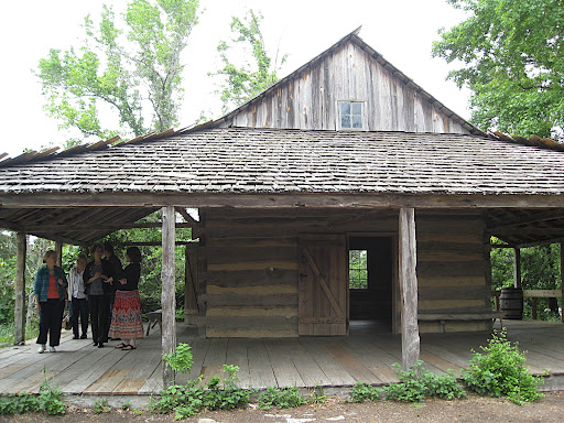 The log cabin in the East Texas area was my absolute favorite. It is a very old, original structure, but I love the huge overhanging roof so that the family could basically live outdoors. I know I could live here happily!