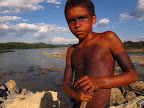 Mikael Juruna (10-year-old son of Jairson Juruna) at the cofferdam. (Photo: Atossa Soltani)