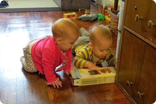 Twins playing with recylcing Boxes