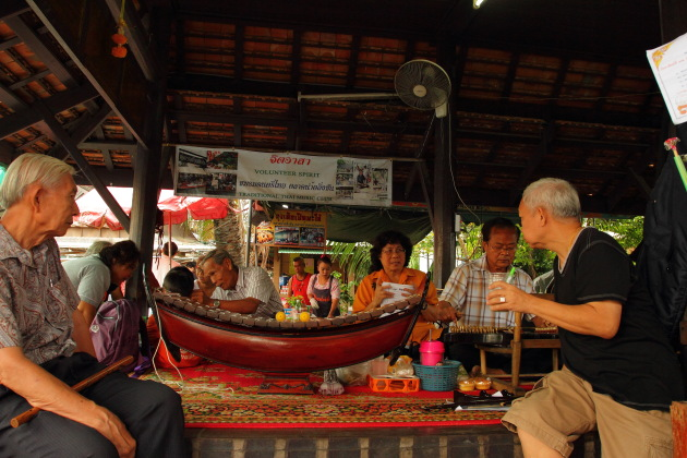 Traditional Music being appreciated by Thai people at Taling Chan Floating Market