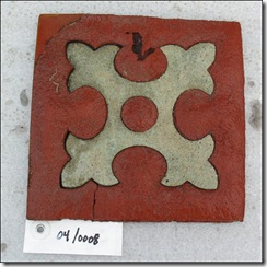 A linoleum Fleur de lis tile  used throughout second and third class public spaces  is in great shape.