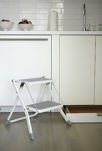 My absolute favorite feature!  A drawer, installed in the toe kick under my sink cabinet, holds a folding step stool from Polder (polder.com).  I pull it out when needed and when I'm finished, it goes back into the drawer.