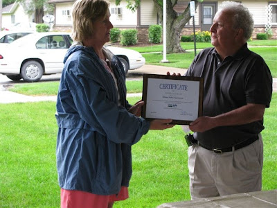 Kim Regennitter (USDA Rural Development) and Phil Ropp (Kalona Valley Apartments board president)<br /> Photo Courtesy of USDA