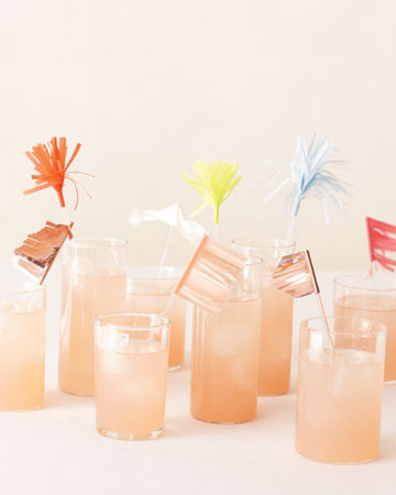 Plexiglas stirrers add punch to signature drinks when they're decked out with petite pennants and pom-poms reminiscent of fireworks. (marthastewartweddings.com)