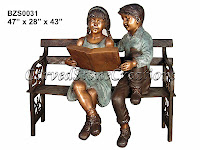 Boy and Girl Reading Book on Bench