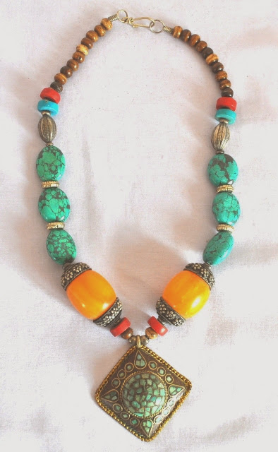 Necklace with metal pendant