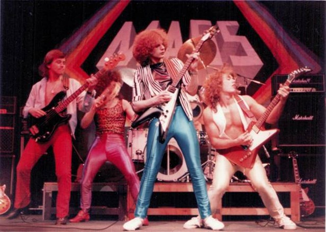 "Here's my Dad rocking out in the early 80's (he's on the far right with the Gibson Explorer and the amazing gold spandex!). Dad had amazing style back then (unfortunately not so much now!). I'd kill to get my hands on some of his old band tees and vintage watches. The matching colour pop spandex is also an instant hit...!"" -  Emily, Rock N' Rose"