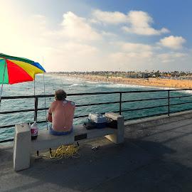 Colorful Umbrella by Jose Matutina - City,  Street & Park  Street Scenes ( colorfule, umbrella, pier, huntington beach,  )