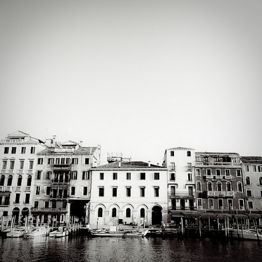 A black and white photo gives you a better perception of the architecture of the city. The buildings look as if they are literally floating on the water -- and they are! (designspiration.com)