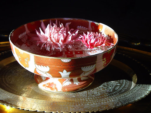 Dahlia's floating in an export porcelain bowl.