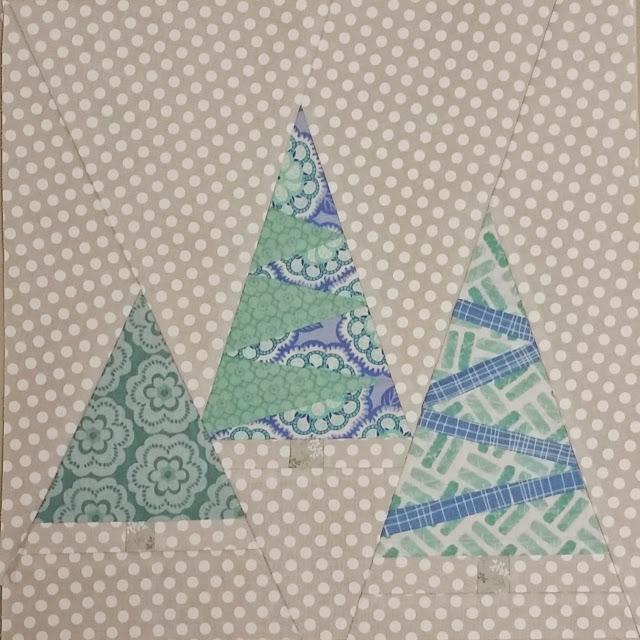 http://aquiltingchick.blogspot.com/2015/01/not-so-last-minute-christmas-quilt.html