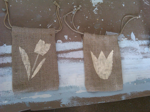 We loved the idea for tulip-bulb favor in a stenciled burlap bag. We tested a couple of stencils before choosing the one on the left.