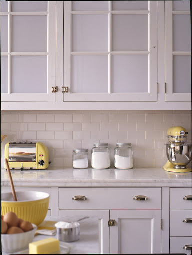 Opaque glass in cabinet doors gives the kitchen a light feeling while still concealing cabinet contents.