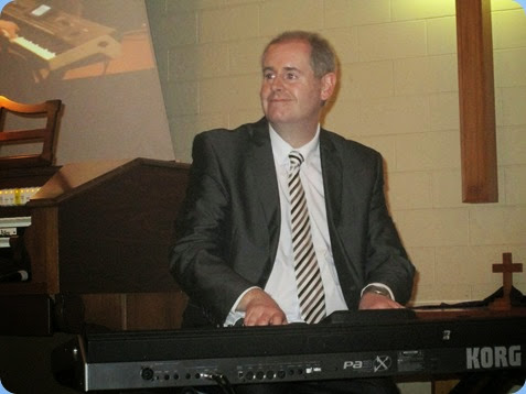 Chris Powell relishing playing the Korg Pa3X. Photo courtesy of Dennis Lyons.