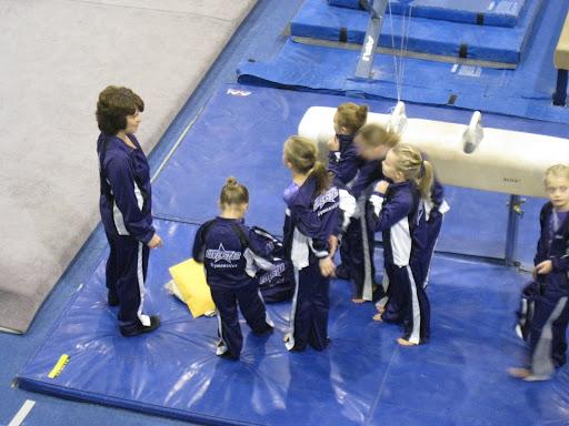 Coach Terri gives the girls a pep talk.