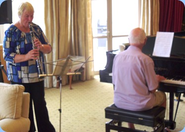 Colleen and John Perkin dueting for the members and residents. Colleen on her Clarinet and John accompanying on grand piano.