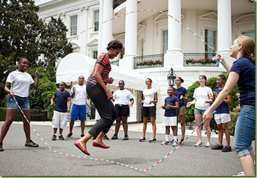 First Lady Michelle Obama and kids double-dutch jump rope during a taping for the Presidential Active Lifestyle Award (PALA) challenge and Nickelodeon&#39;s Worldwide Day of Play, on the South Lawn of the White House, July 15, 2011. (Official White House Photo by Chuck Kennedy)&#10;&#10;This official White House photograph is being made available only for publication by news organizations and/or for personal use printing by the subject(s) of the photograph. The photograph may not be manipulated in any way and may not be used in commercial or political materials, advertisements, emails, products, promotions that in any way suggests approval or endorsement of the President, the First Family, or the White House.