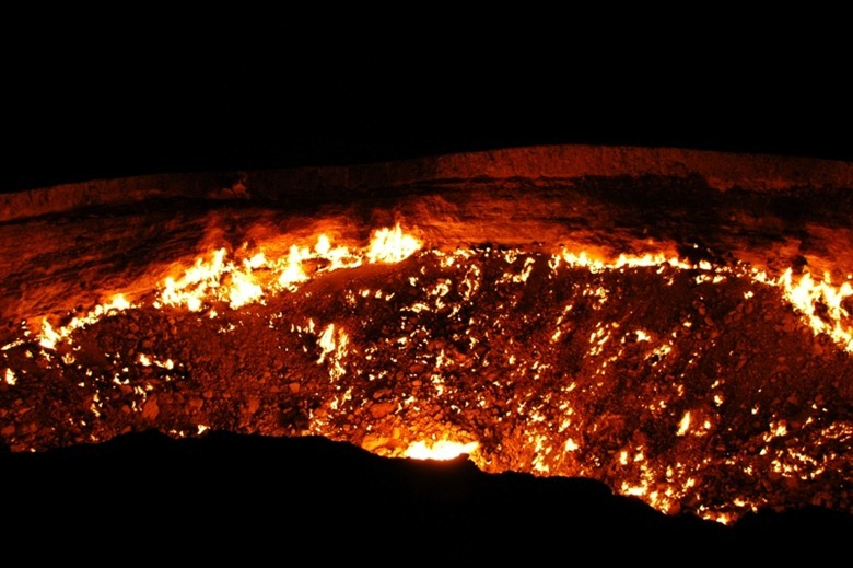 Perhaps the most accurate, living representation of hell we've ever seen, flames lick up, fueled by escaping natural gas at the Darvaza gas crater.  <br /><br />We spent a remarkably peaceful night camping at the crater's edge.