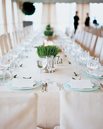 Quiet, aqua chargers are brought to life with simple grass clusters as centerpieces. (http://www.marthastewartweddings.com/)