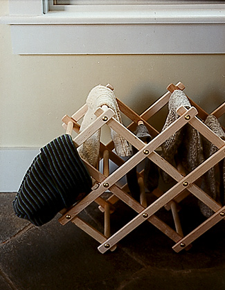 This collapsible wine rack is perfect for organizing and drying out mittens, hats and other snow day wear in winter.