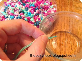 Threading the Necklace - The Cozy Nook