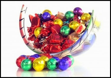 7354958-christmas-sweets-in-a-glass-bowl-with-reflection-on-white