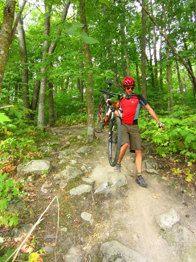 Hiking the bike through a rock garden